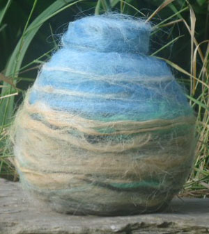 Small wool-covered vessel.